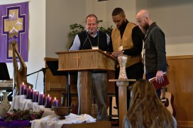 Prior to the sermon at ACA, Conference Minster Dick Barrett (left) prays with speakers David Hargrave (center) and Joel Miller, pastors at Salem Mennonite Church in Wooster.