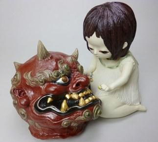 少女が鬼の生首に飴をあげているところ。輪廻転生と魂の浄化がテーマです。