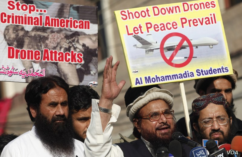 Hafiz Saeed, head of the Jamaat-ud-Dawa organisation and founder of Lashkar-e-Taiba, (2nd R) addresses supporters during a protest against U.S. drone attacks in the Pakistani tribal region, in Lahore, Nov. 29, 2013.