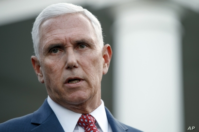 Vice President Mike Pence speaks to reporters outside the West Wing of the White House, Monday, Oct. 14, 2019, in Washington…
