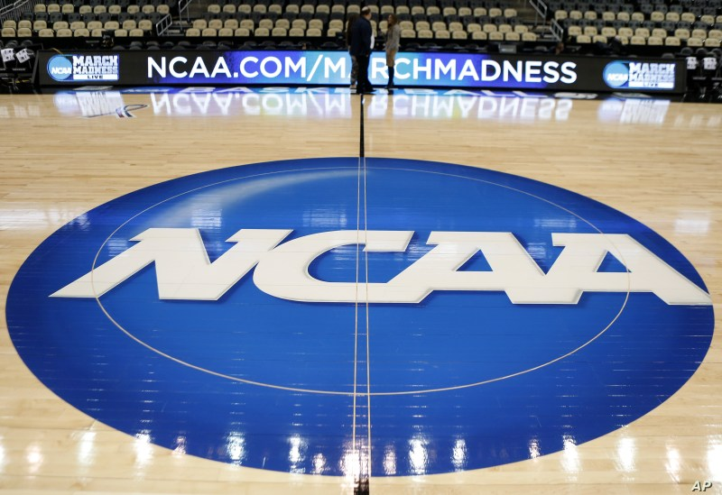 FILE - The NCAA logo is seen at center court at The Consol Energy Center in Pittsburgh, Pennsylanvia, March 18, 2015.