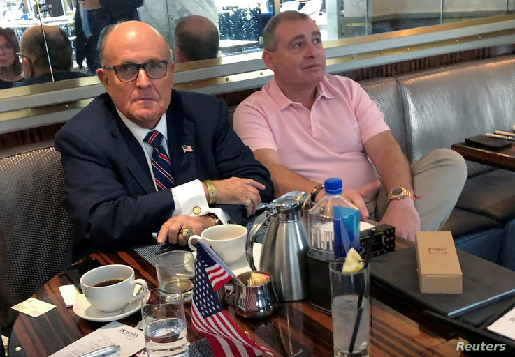 FILE - Rudy Giuliani is seen with Ukrainian-American businessman Lev Parnas at the Trump International Hotel in Washington, Sept. 20, 2019. Parnas has been arrested with another associate of Giuliani's, Igor Fruman, a Belarus-born U.S. citizen.