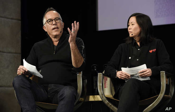 John Cooper, left, director of the Sundance Festival, and Kim Yutani, the festival's director of programming, take part in the…