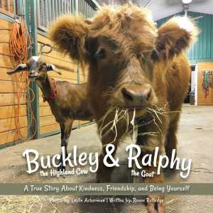 The cover image of Buckley & Ralphy shows a cow and a goat in a barn chewing hey.