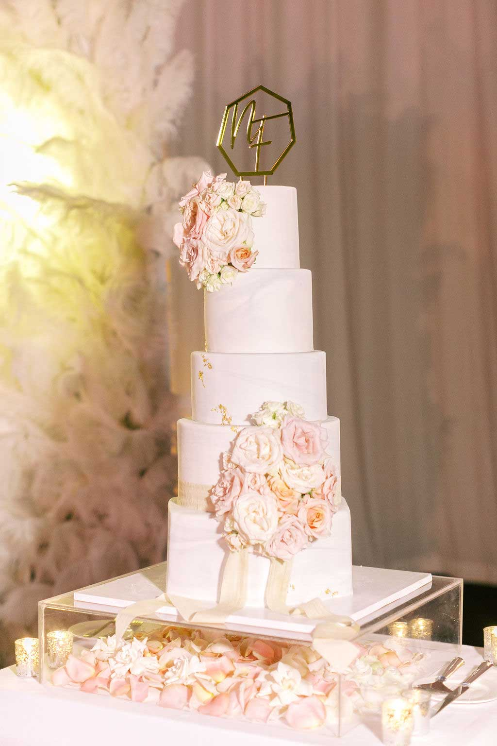 side angle of the five tiered wedding cake