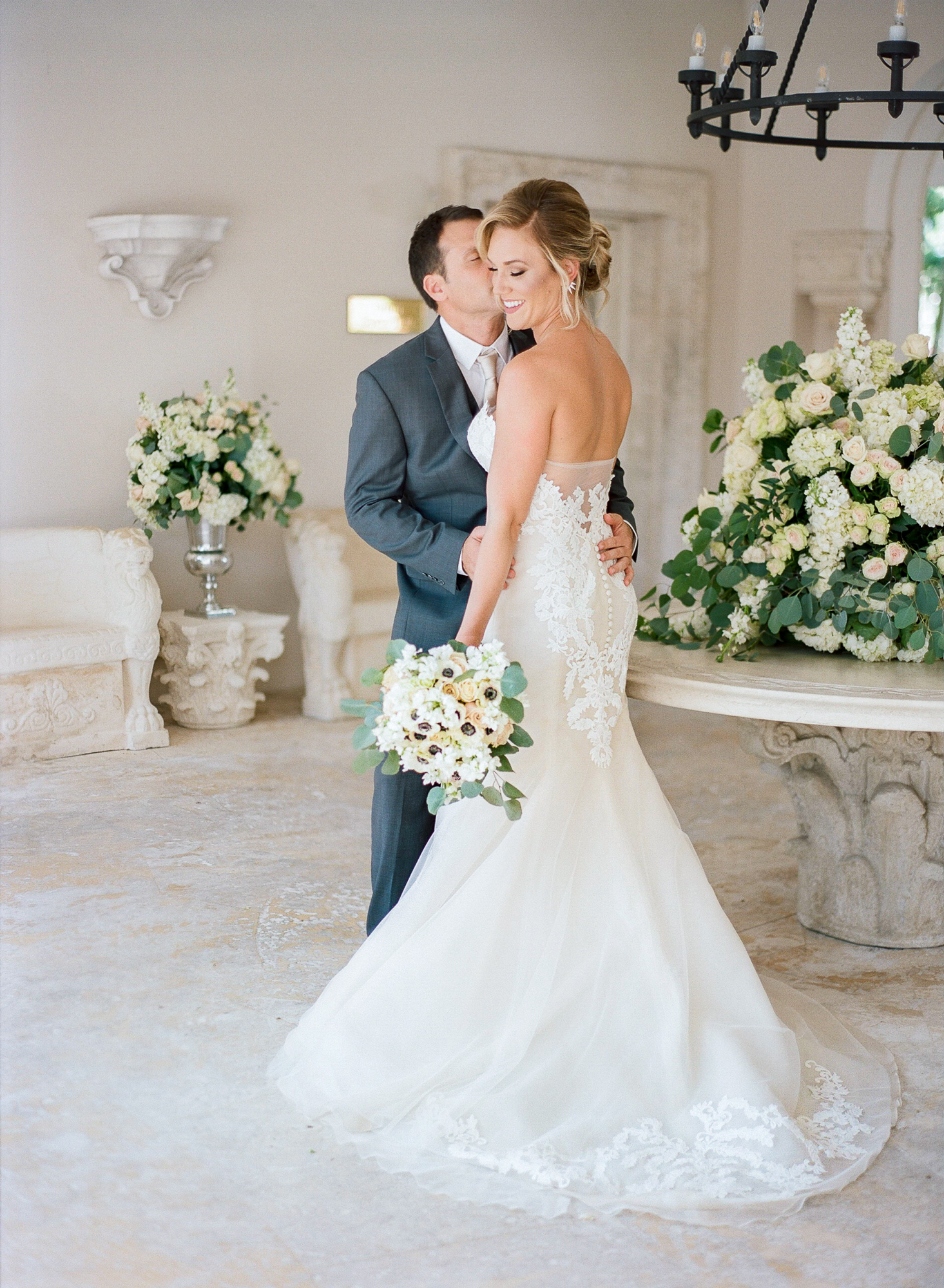 Groom kisses bride for their first looks at the Fisher Island Club.