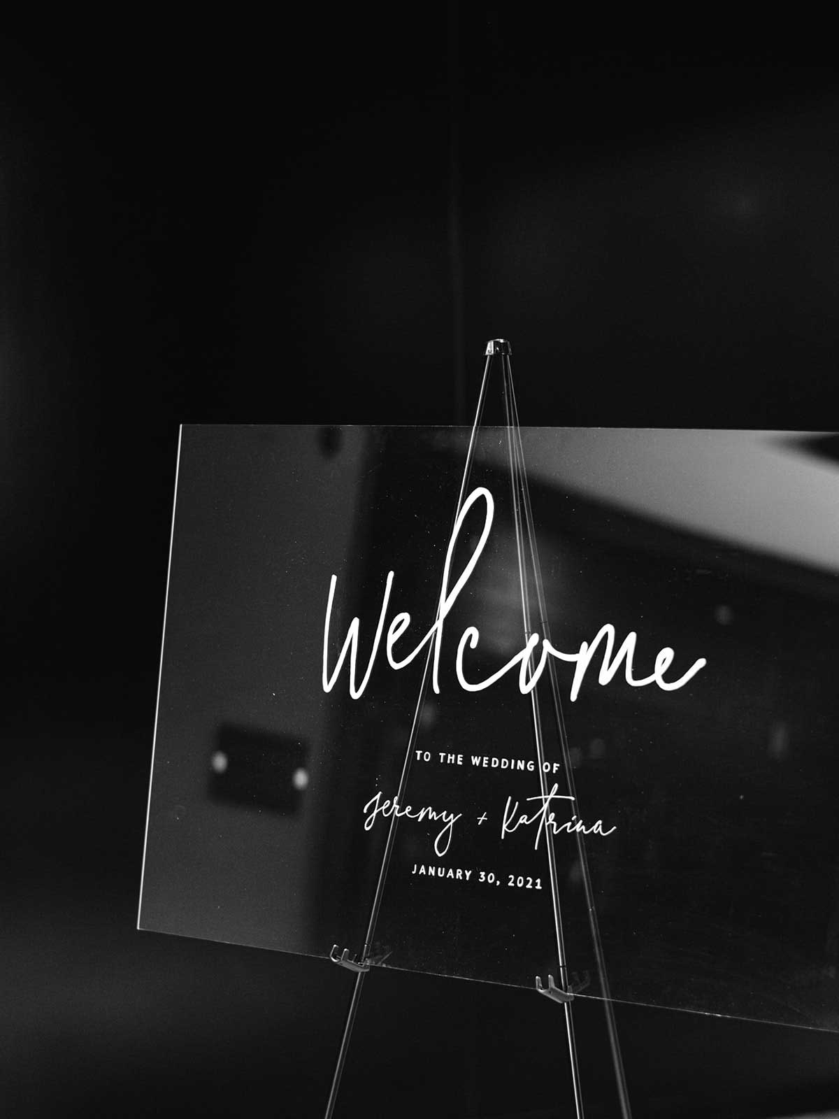 acrylic welcome sign with black background.