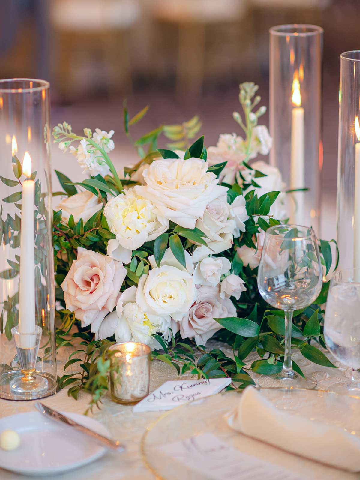 floral centerpiece with candles.