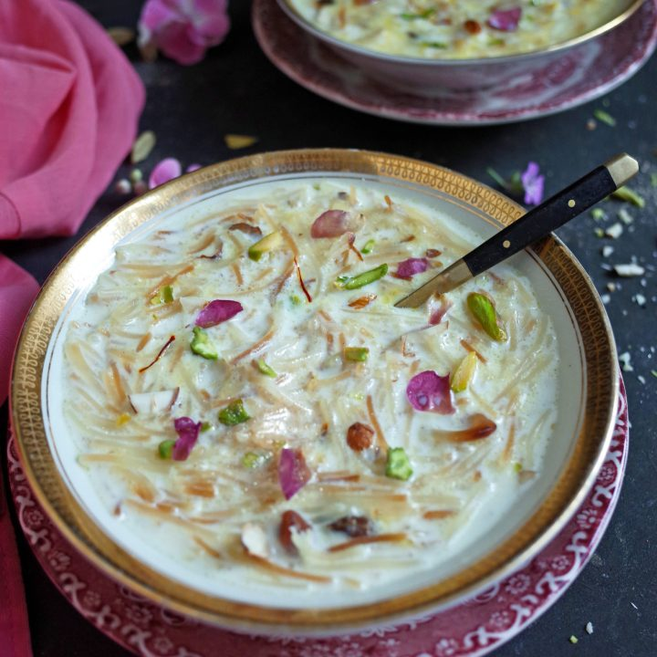Seviyan Kheer topped with rose and pistachio in a white and gold bowl