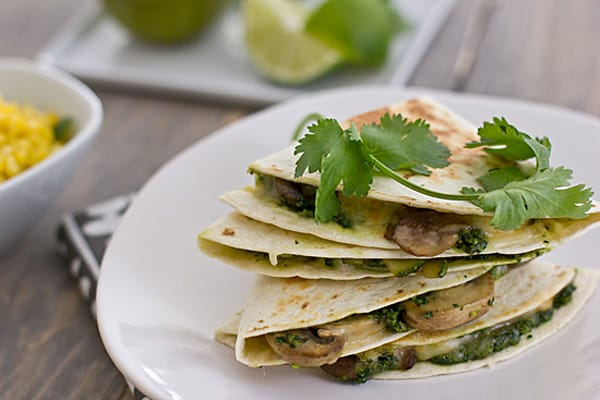 Mushroom Zucchini Quesadillas with Cilantro Pesto sitting on table