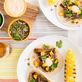 Beer-Marinated Grilled Mushroom Tacos with Pepita Relish & Chipotle Crema Recipe sitting on white plate
