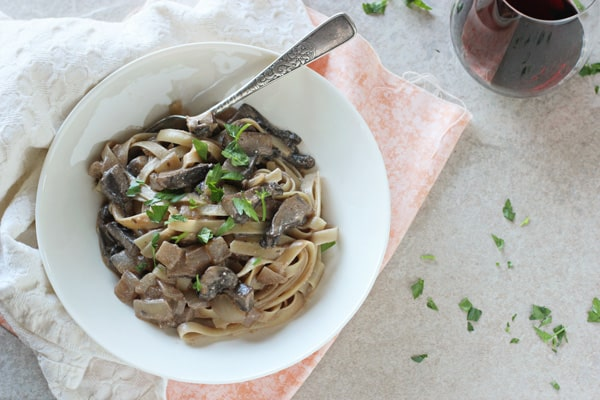 Portabella Stroganoff in white plate on a table