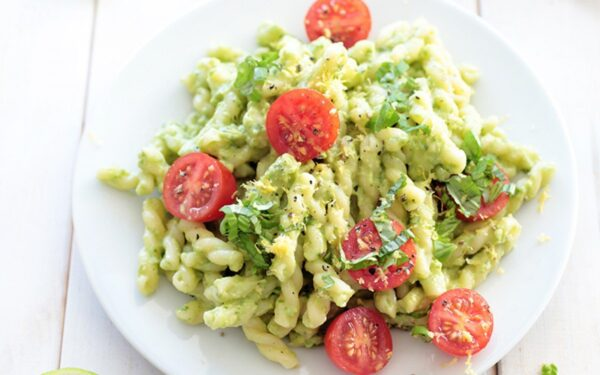 creamy avocado pasta with cherry tomatoes