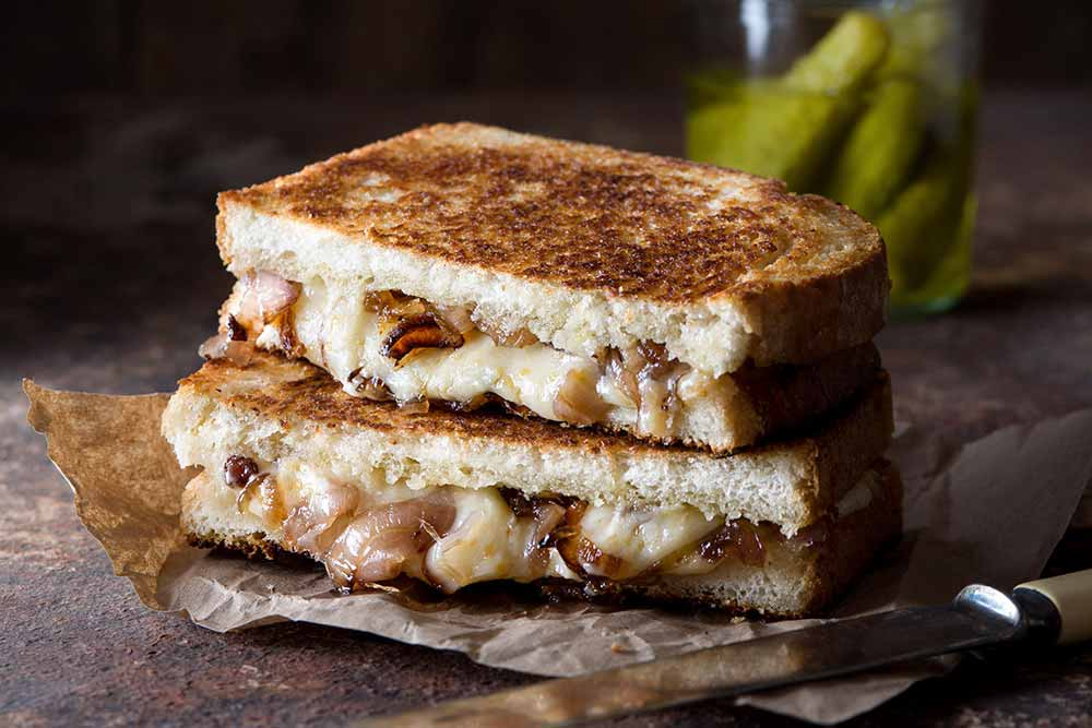 21 Mind-Blowing Grilled Cheese Sandwich Recipes: Grilled Cheese Sandwich with Tarragon and Bourbon Caramelized Shallots