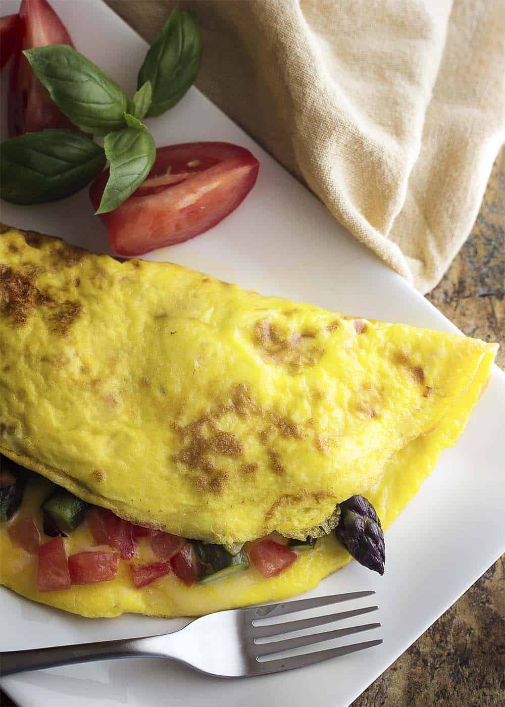 15 Irresistible Vegetarian Omelets to Make for Breakfast: Smoked Gouda Asparagus Omelette