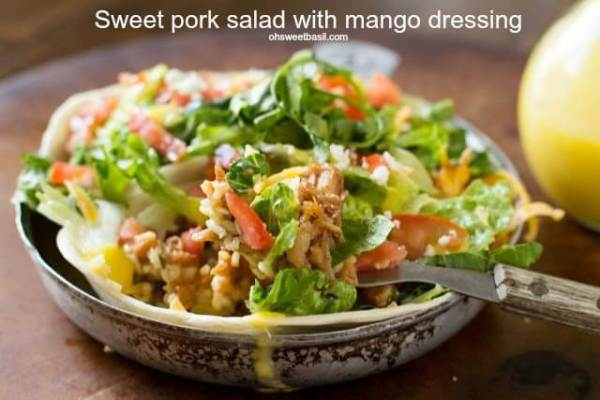 Sweet Pork salads stuffed with cilantro lime rice, beans and a killer mango dressing. ohsweetbasil.com