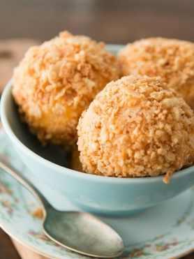so easy!! mango fried ice cream with a macadamia crust and white chocolate coconut sauce ohsweetbasil.com