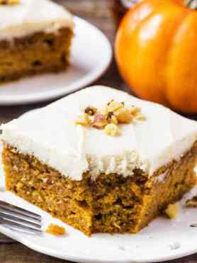 This pumpkin cake with maple frosting is the perfect fall dessert. The cake is moist & filled with warm fall spices, and you'll love the sweet maple buttercream. ohsweetbasil.com