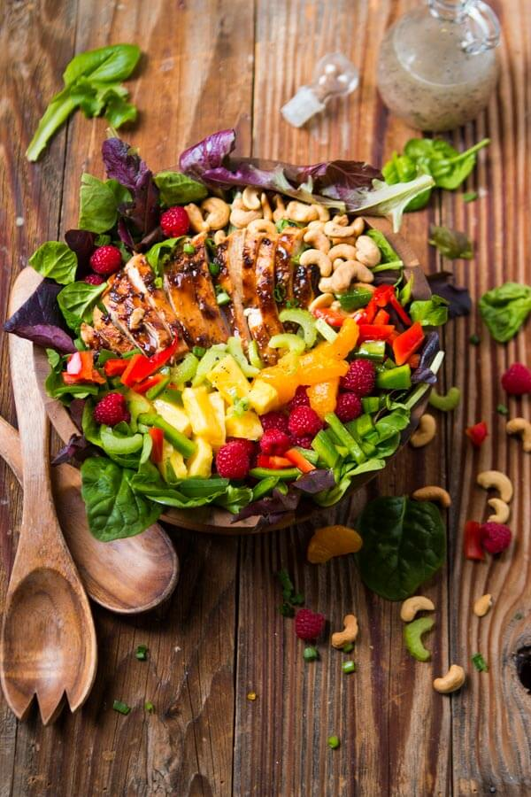 Our most favorite salad, easy teriyaki chicken salad!! It's so easy and perfect for all summer long! Juicy chicken, veggies, fruit and crunchy cashews!