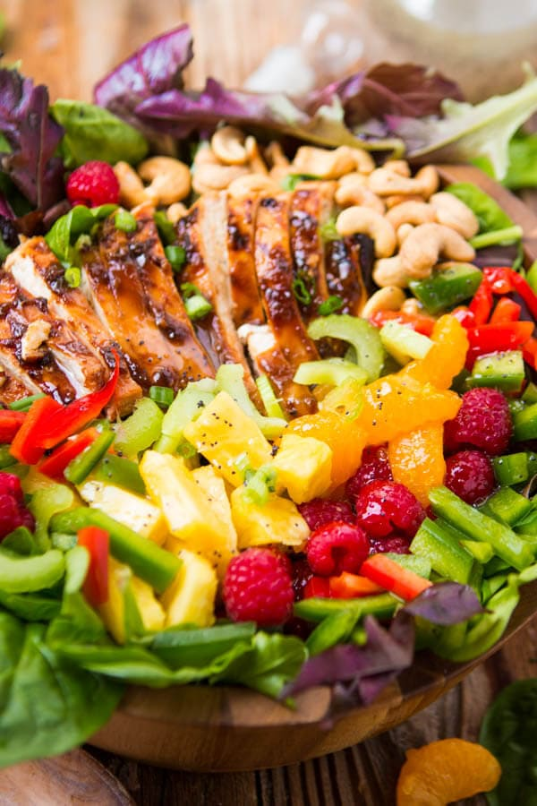 Our most favorite salad, teriyaki chicken salad!! It's so easy and perfect for all summer long! Juicy chicken, veggies, fruit and crunchy cashews with a poppy seed dressing ohsweetbasil.com