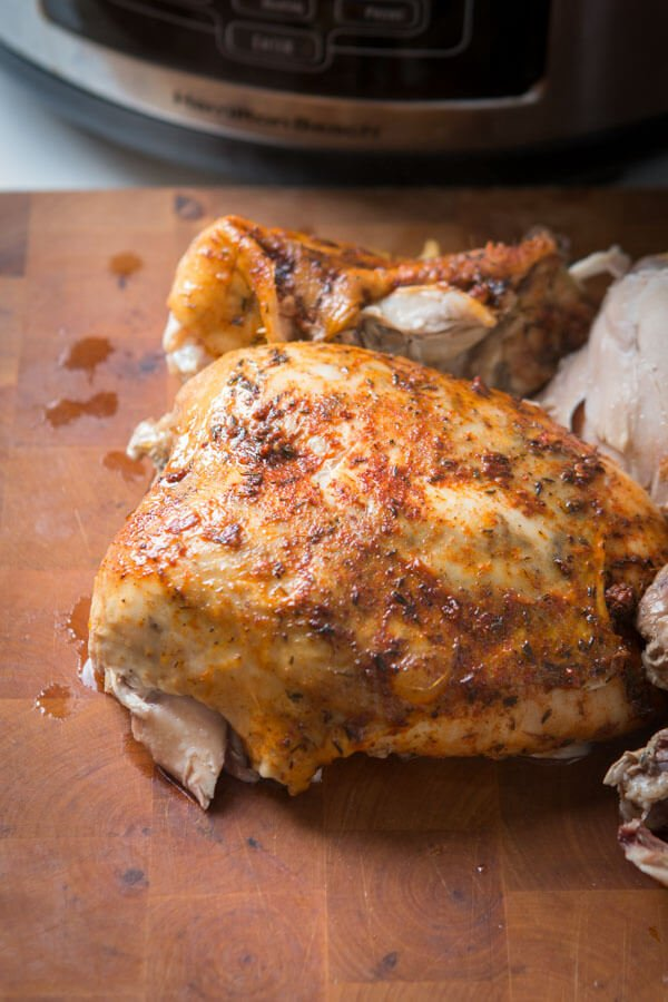 Whole Chicken on a wood cutting board.