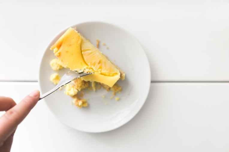 sliced dessert on top of white ceramic plate
