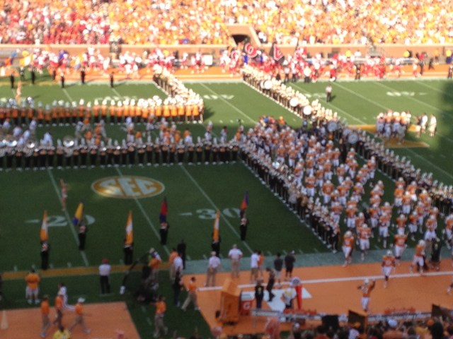 Players and cheerleaders run through the T to pump up the crowd in Neyland Stadium!