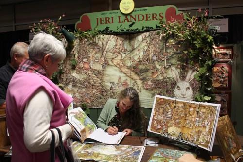 Jeri Landers autographing a book featuring Hopalong Jack.