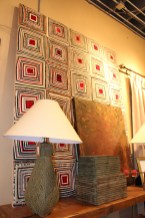 A quilt mounted on a stretcher frame fills a wall with color at ROOST, Maryville TN