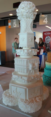 Fleur de lis base supports the tallest entry in the Wedding Cake category