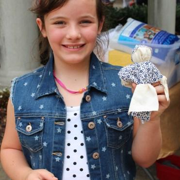 Branleigh holds her handmade doll