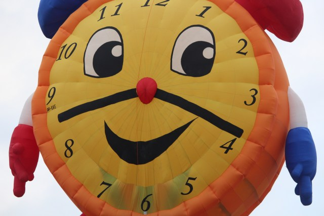 Cheery side of clock balloon -- Balloon Fiesta 2014