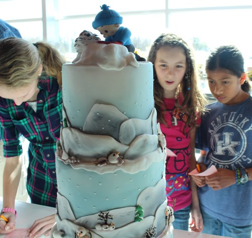 Studying the detail on a Calvin and Hobbes cake in The Great Cake Bake 2014
