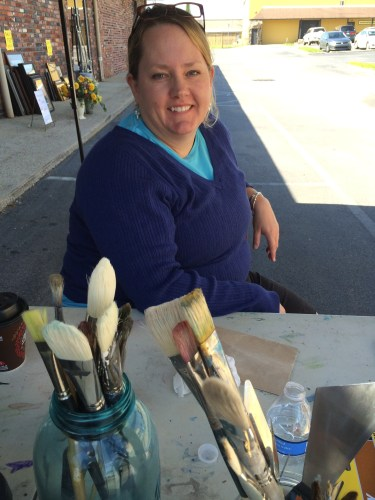 Cynthia Tipton waits for a five-foot canvas under the tent where she'll demonstrate her craft.