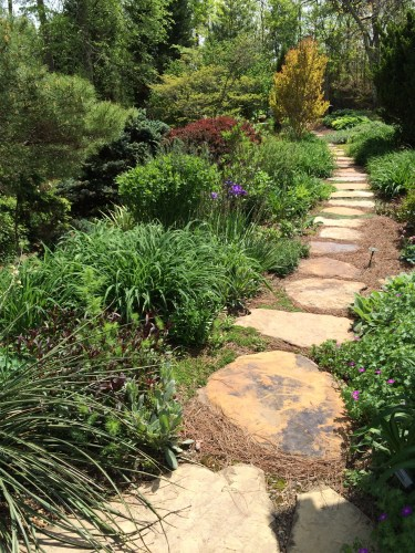 Stone pathway leading to another garden area at the home of Tom Boyd and Sandi Burdick