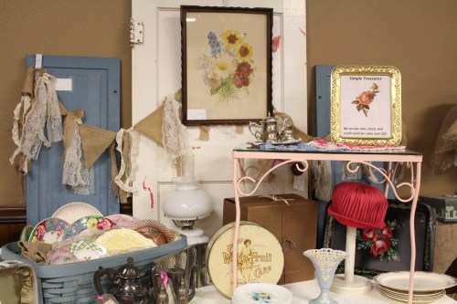 Artfully arranged vintage items filled the booth of Simple Treasures Antique & Vintage.