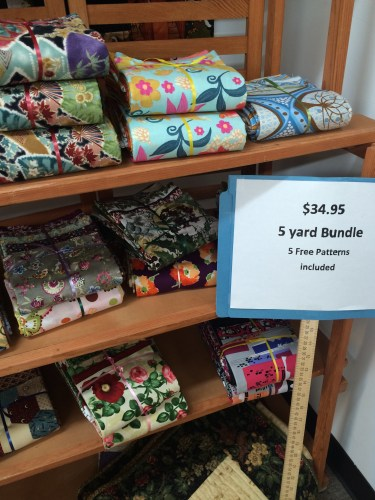Five-yard bundles line the shelves at Loose Threads in Harriman, TN