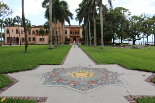 A beautifully symmetrical patterned walkway leads to Ca' d'Zan at The Ringling in Sarasota, Florida.