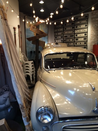 Vintage 1960 Morris Minor greets you as you enter Elm & Iron OTR. Want to take a test drive?