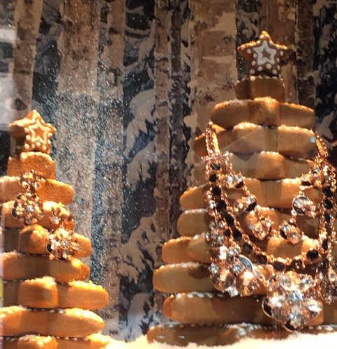 Stacked gingerbread trees hold tempting baubles at the Lord & Taylor windows, New York City.