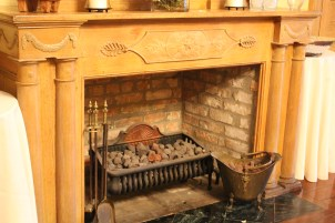 Wood-burning fireplace and antique mantel: Napoleon House, New Orleans