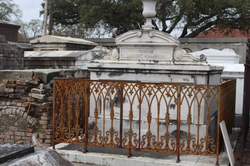 Decorative ironwork frames a family tomb in St. Louis Cemetery 1, New Orleans.