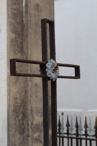 An iron cross in St. Louis Cemetery 1