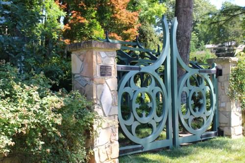 Elegantly curved garden gate.