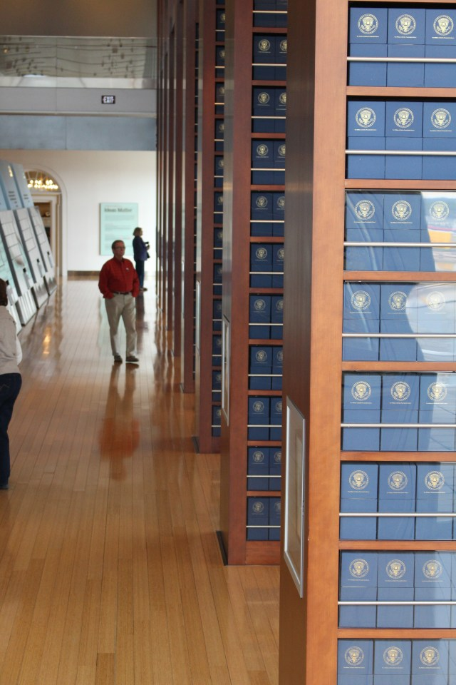 Bert's taking a long look at all that paper -- almost 5,000 boxes of archives in floor-to-ceiling columns.
