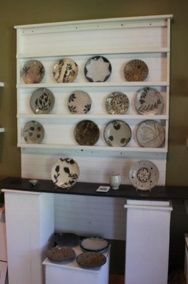 Plates on display inside Kline's workshop