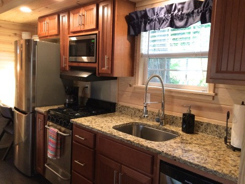 Fully-equipped kitchen in a rentable tiny house in Flat Rock.