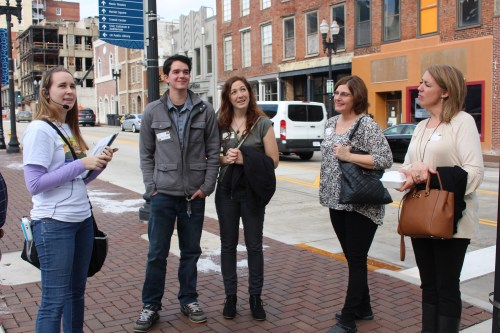 Showing us the Bijou and the new Knoxville sidewalks, Lauren Quinn relays a little history of the area for our tour.