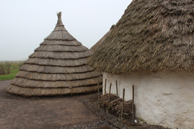 Neolithic thatched cottages at Stonehenge Visitor Centre, Salisbury, England.