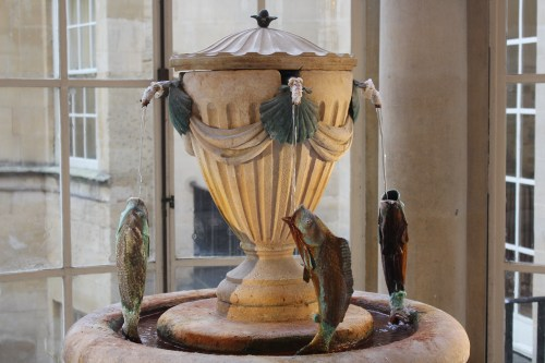 Offering safe drinking water is this decorative urn located in the Grand Pump Room of the Roman Baths.
